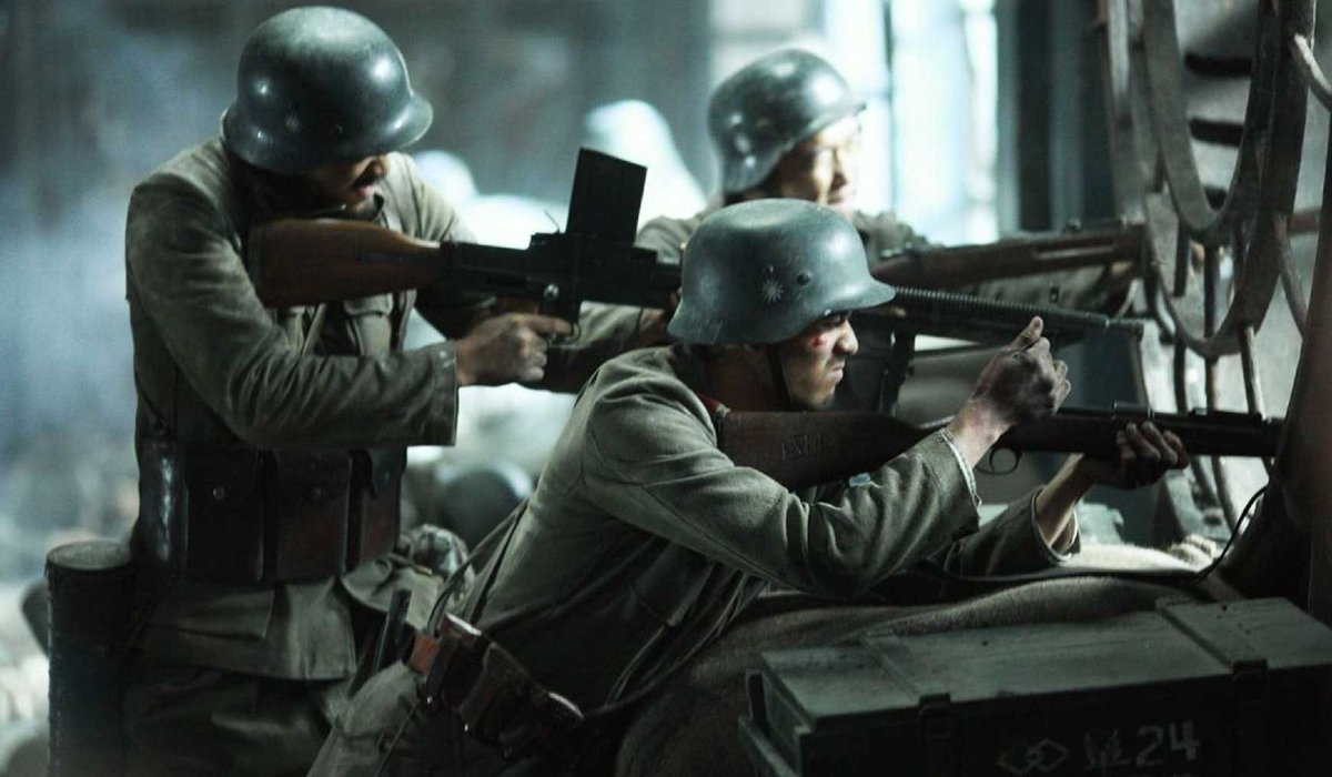 The Eight Hundred soldiers aiming weapons out the window