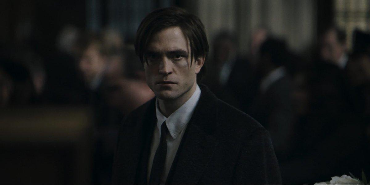 The Batman Robert Pattinson as Bruce Wayne in a black suit