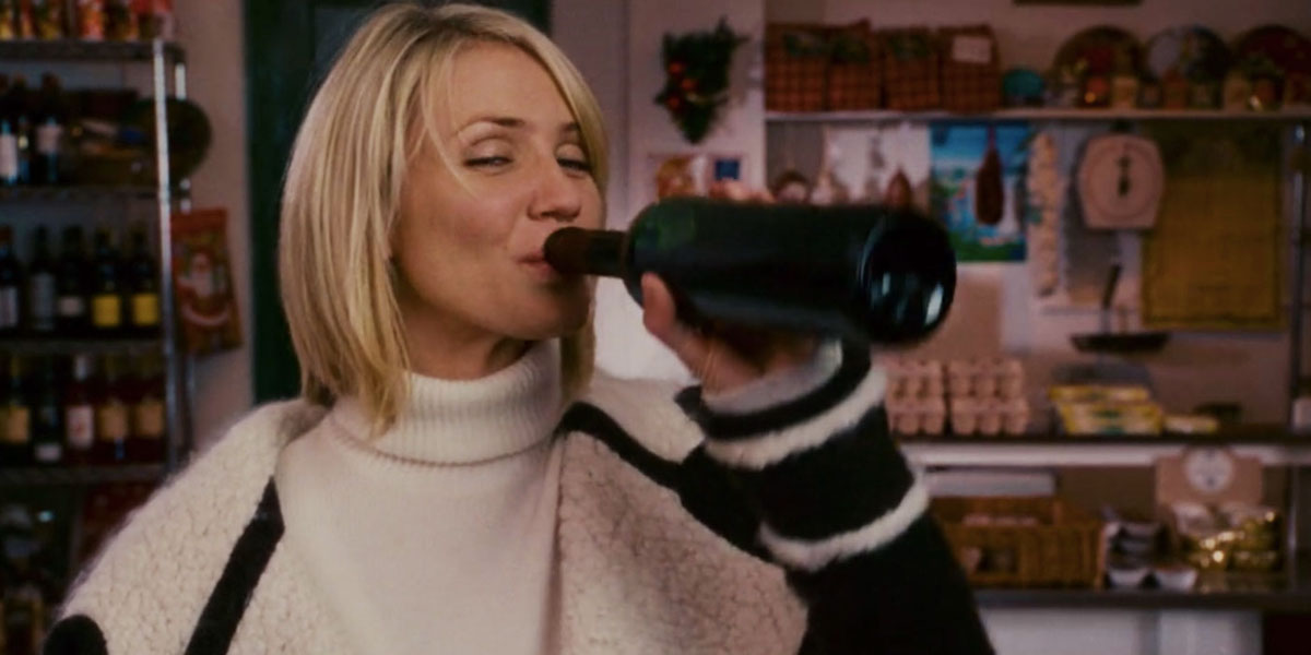Amanda (Cameron Diaz) drinks straight from a red wine bottle in 'The Holiday'