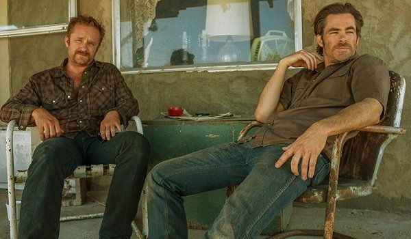 Hell or High Water Ben Foster and Chris Pine sitting on a rusty front porch