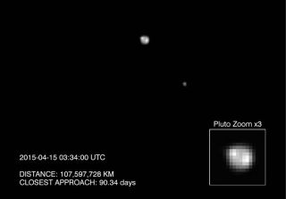 NASA's New Horizons spacecraft snapped this photo of Pluto (center) and its largest moon Charon on April 15, 2015 by the probe's Long Range Reconnaissance Imager. The image, which hints at surface features, is one of several views captured over several d
