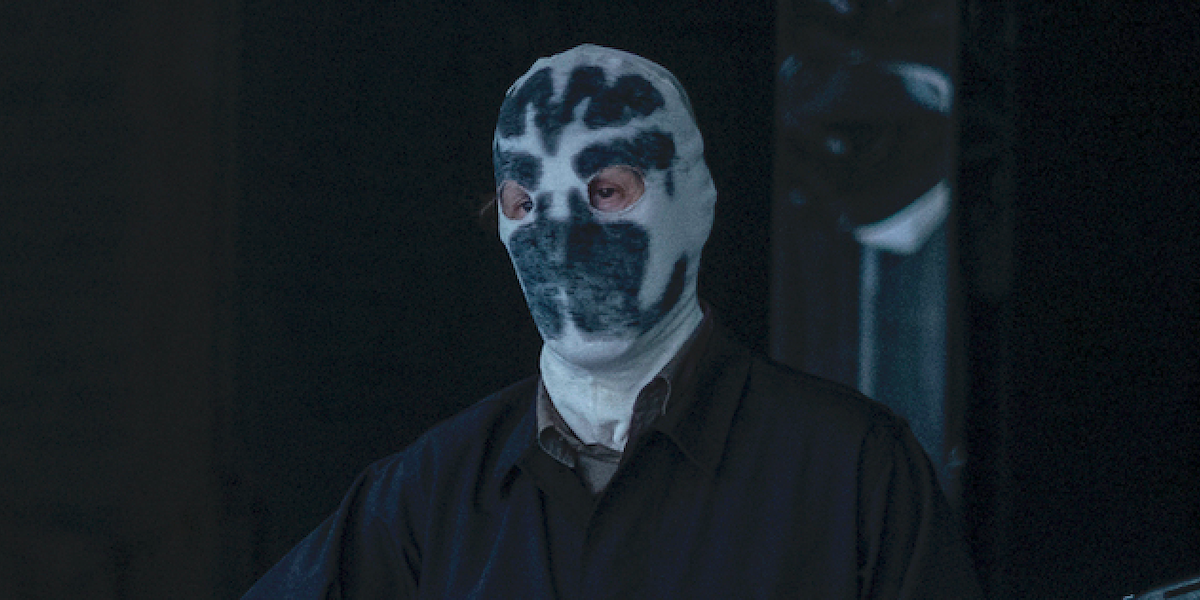 hbo watchmen looking glass in rorschach mask