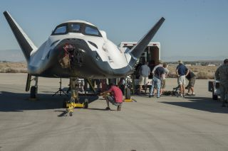 Sierra Nevada Corp.'s Dream Chaser space plane undergoes ground taxi tests at NASA's Armstrong Flight Research Center in 2013. Sierra Nevada is protesting NASA's recent award of commercial space taxi contracts to competitors SpaceX and Boeing.
