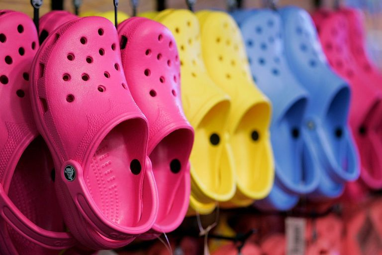pink, yellow and blue crocs