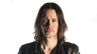 A photograph of Myles Kennedy taken in a studio