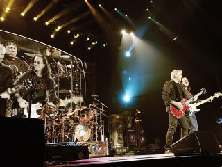 Rush perform onstage as part of their recent Time Machine tour