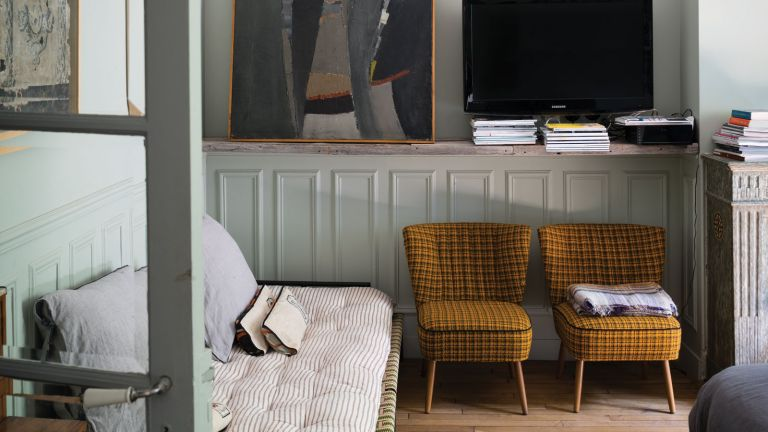 two chairs and a sofa in a grey room