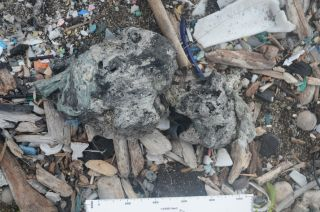 image of plastiglomerate rock material on hawaii's kamilo beach.