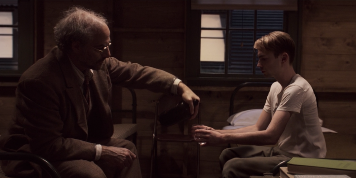 Stanley Tucci and Chris Evans drinking in Captain America: the First Avenger