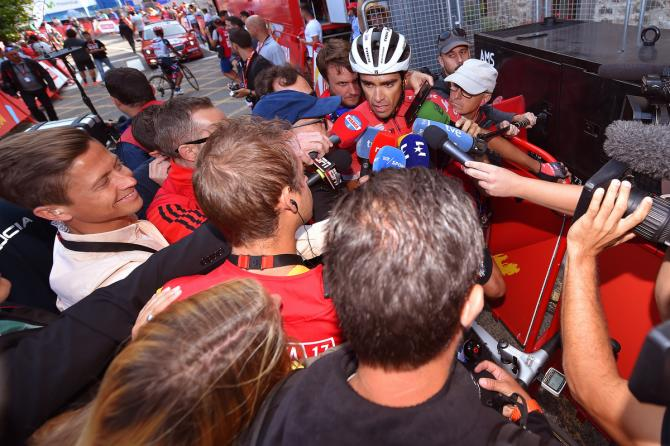 Par for the course, Alberto Contador is swamped by the press after another stage of the Vuelta