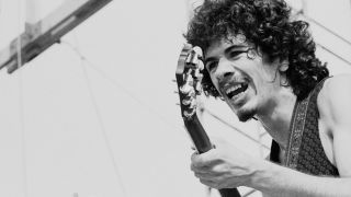 Mexican-born American musician Carlos Santana (right) and American bassist David Brown perform with the other members of Santana at 'Woodstock,' a large rock and roll music concert, Bethel, New York, August 16, 1969.