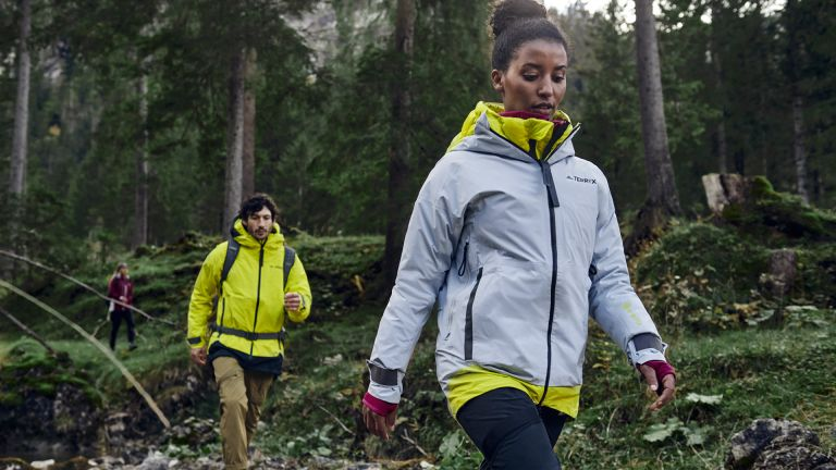 best waterproof jacket: people wearing Adidas Terrex SS21 Hike collection on a woodland hike