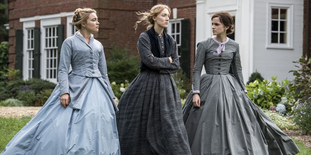 Florence Pugh, Saorise Ronan and Emma Watson walking in corset dresses in Little Women