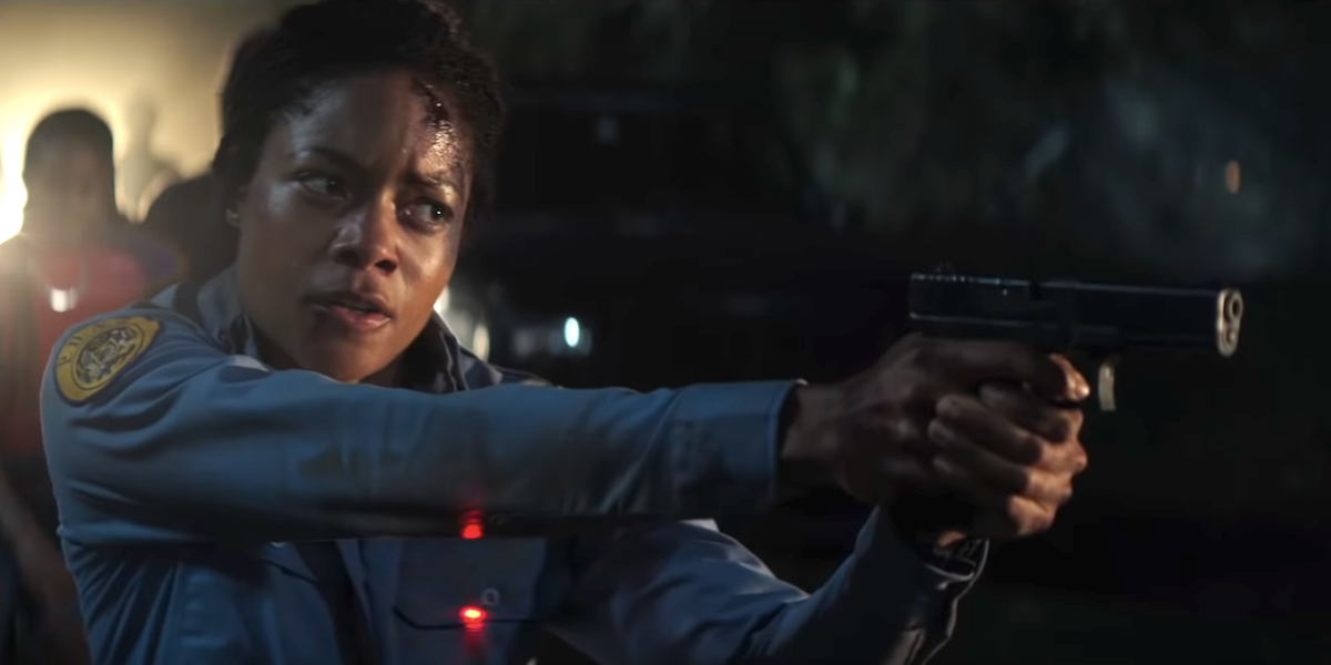 naomie harris black and blue bloody pointing gun