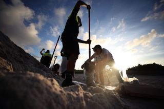 Park officials fill sandbags for residents who are preparing for Hurricane Irma on Sept. 7 in Miami Beach, Florida.