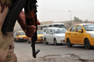 Iraqi soldier in Baghdad traffic