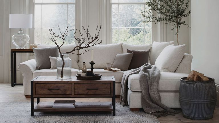 living room with white and wood scheme by furniture village
