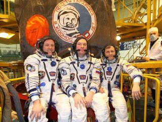 At the Baikonur Cosmodrome in Kazakhstan, NASA astronaut Ron Garan (left), Expedition 27 flight engineer; along with Russian cosmonauts Alexander Samokutyaev (center), Soyuz commander; and Andrey Borisenko, flight engineer, pose for pictures outside their