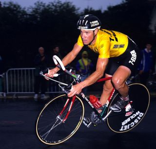 7-Eleven's Steve Bauer in the leader's yellow jersey at the 1990 Tour de France on a time trial frame in similar colours to the Eddy Merckx Corsa Extra available on eBay