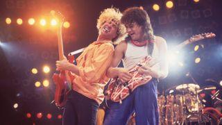 Rock musicians Sammy Hagar and Eddie Van Halen (1955 - 2020), both of the group Van Halen, performs onstage at the Rosemont Horizon, Rosemont, Illinois, March 15, 1986.