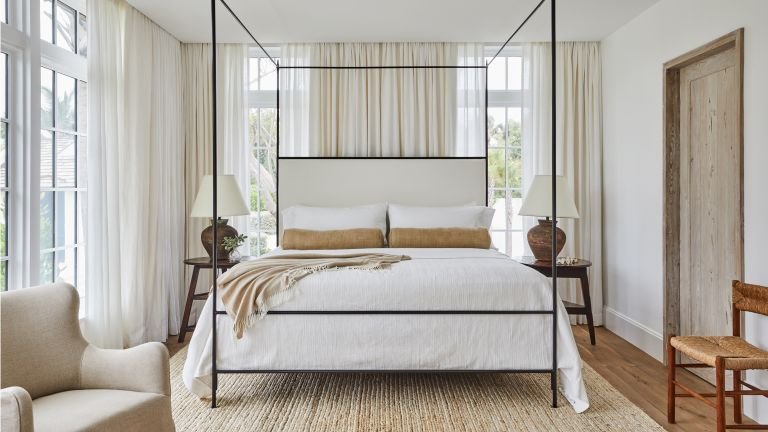 Neutral bedroom with four poster bed