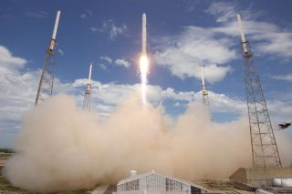 SpaceX's debut Falcon 9 rocket soars into space on its maiden flight during a June 4, 2010 test launch.
