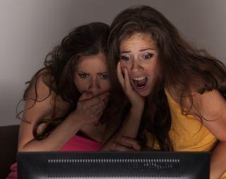 Teens horrified at television.