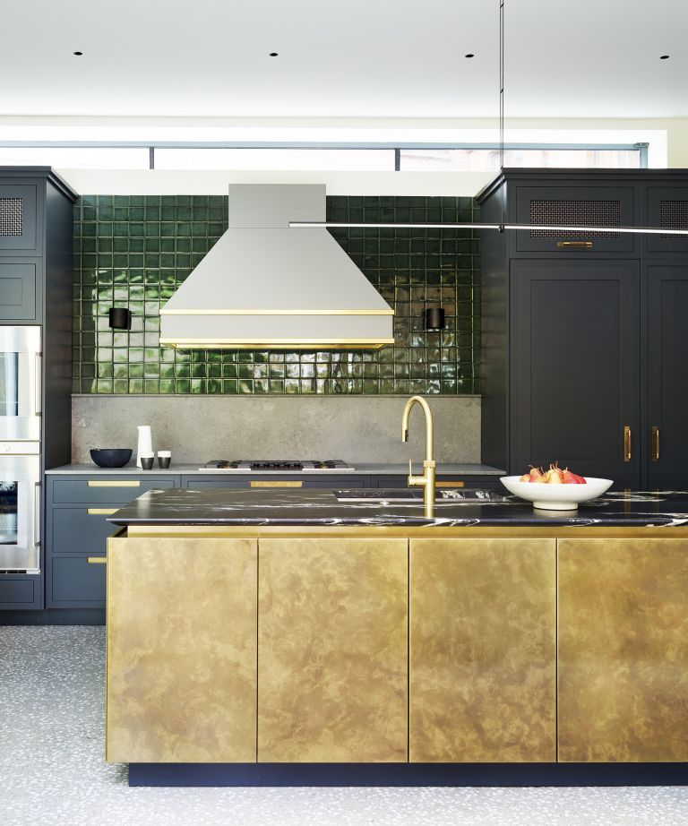 Small green kitchen tile ideas in a midnight blue kitchen scheme with gold accents.