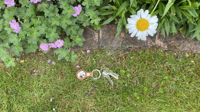 Apple AirTag keys on grass