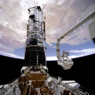 Astronauts fix Hubble on shuttle servicing spacewalk