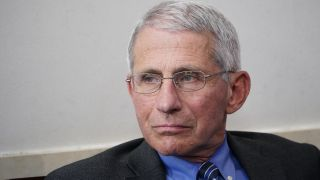 Dr. Anthony Fauci, director of the National Institute of Allergy and Infectious Diseases, listens during a daily briefing on the novel coronavirus at the White House on April 6, 2020, in Washington, D.C.