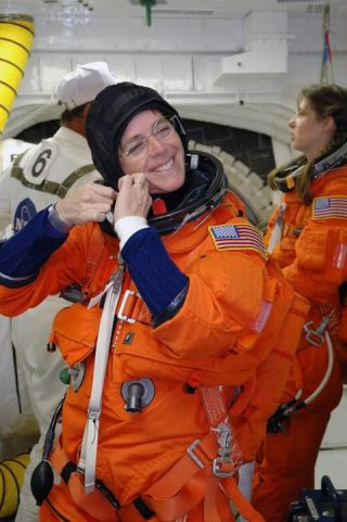 Teacher-Astronaut Marks NASA Anniversary with Shuttle Launch Drill