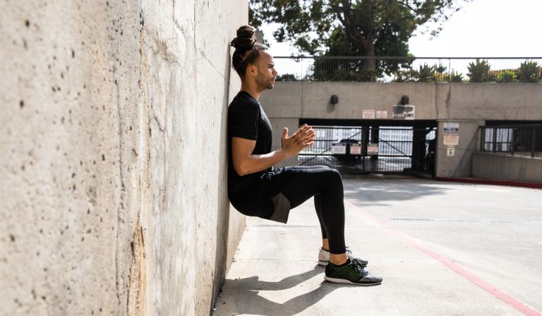 Man doing wall sit