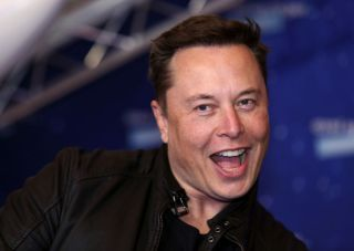Elon Musk pulling a jokey face at the camera.