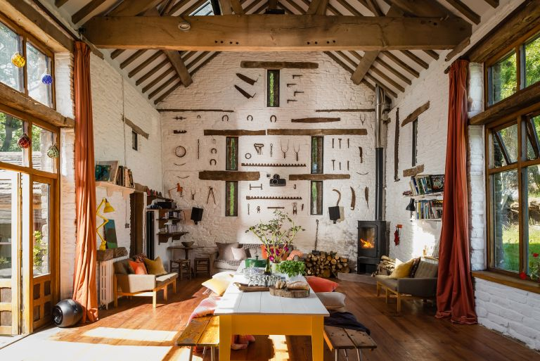 Barn conversions: living room with impressive tool display on far wall