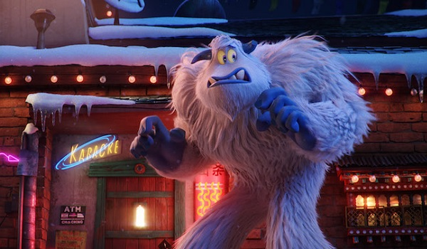 Smallfoot stands in front of a bar, looking really nervous