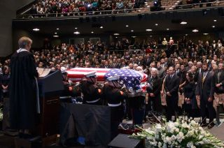Marines carry in the casket of former astronaut and U.S. Senator John Glenn during a ceremony to celebrate his life, Dec. 17, 2016, at The Ohio State University in Columbus.