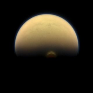 NASA's Cassini spacecraft captured this view of Saturn's hazy moon Titan in January 2013, when it was about 895,000 miles (1.44 million kilometers) from the big moon.