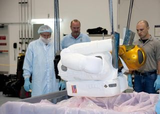 A crane is used to lift the 330-pound Robonaut 2 out of its shipping container at NASA's Kennedy Space Center in Florida.