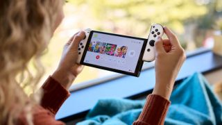 Nintendo Switch OLED joycons connected to base