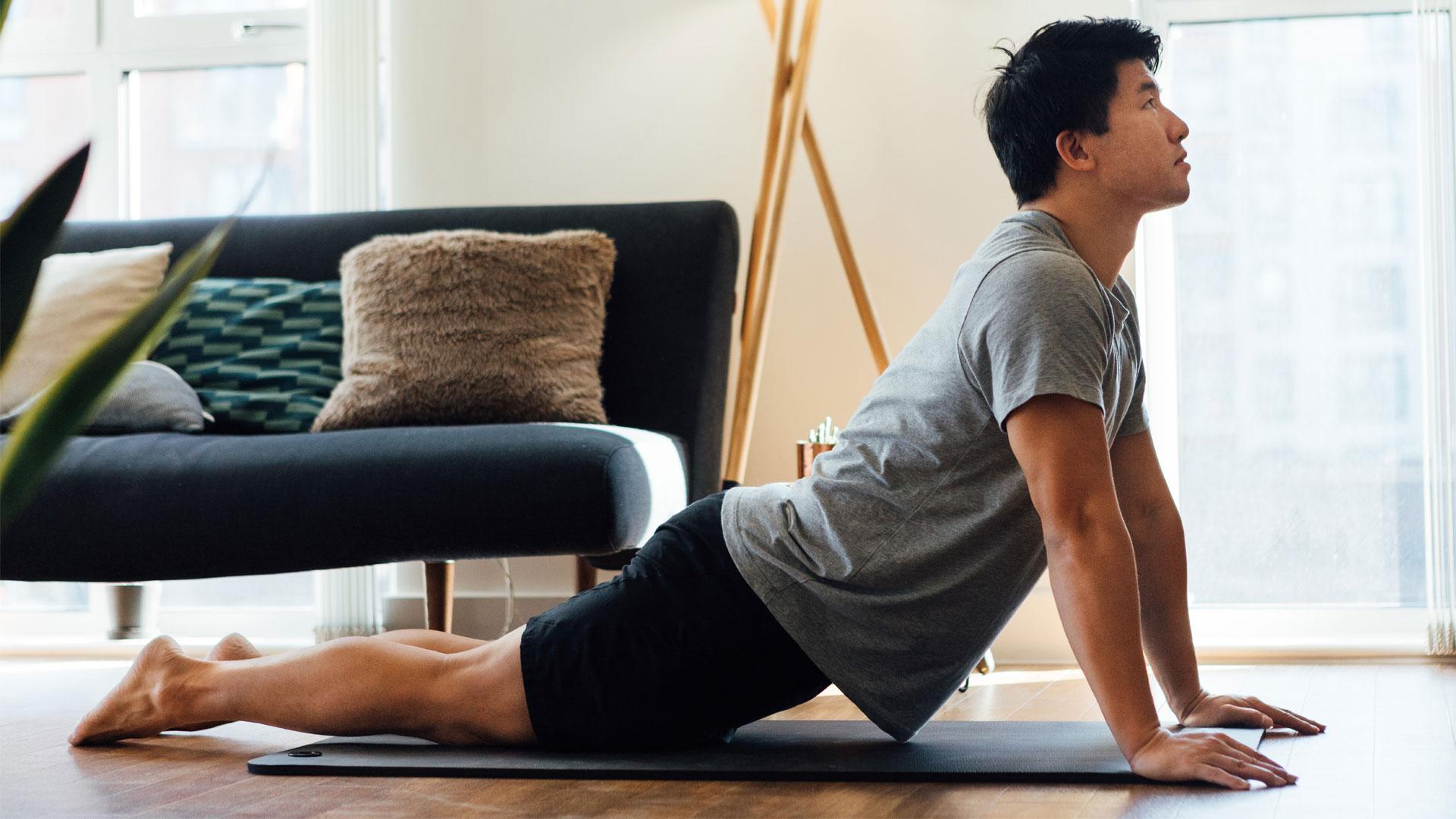 7 types of yoga: Image shows man doing yoga pose