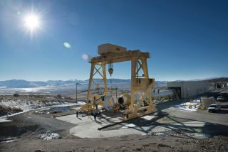 The first qualification motor for NASA's Space Launch System booster sits in the test stand of Orbital ATK's facility in Promontory, Utah, ready for a static-fire test on March 11, 2015.