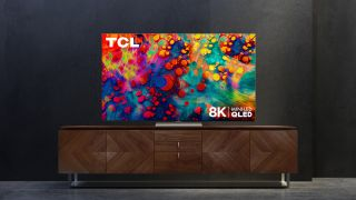 The new TCL 6-Series 8K TV sits on a media cabinet