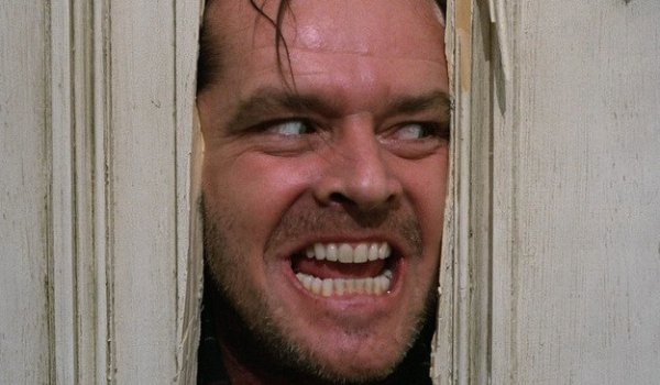The Shining Jack Nicholson peeking out menacingly through the bathroom door