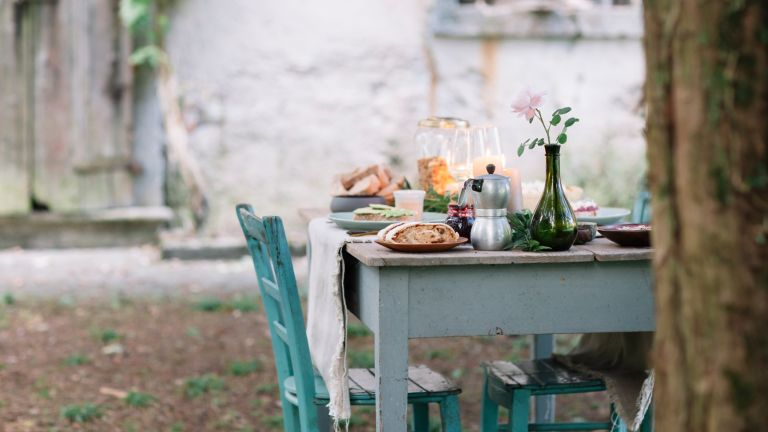 outdoor table laid with food in italian village