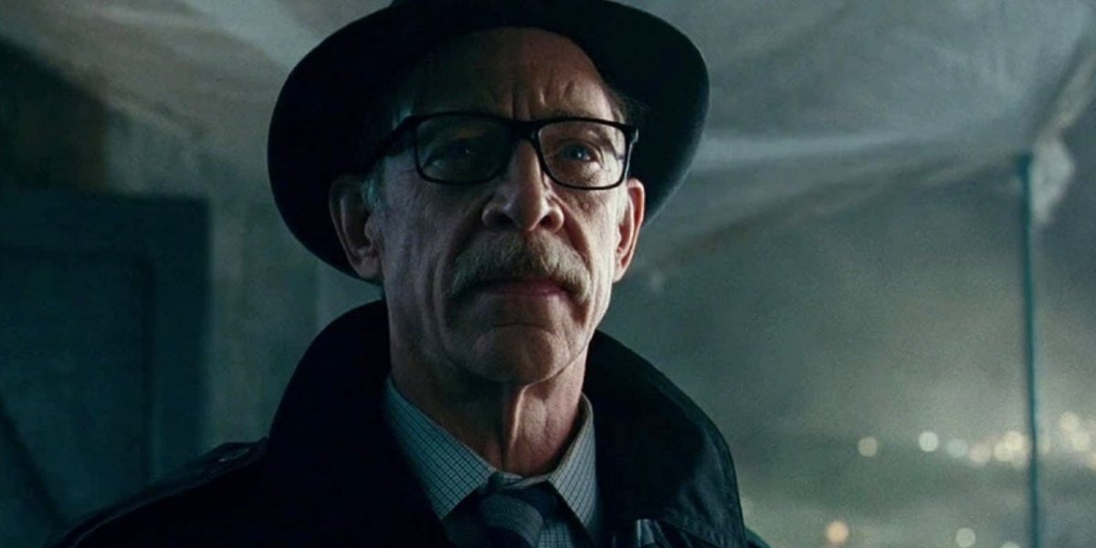 J.K. Simmons stands under a tarp on a rooftop in Justice League.
