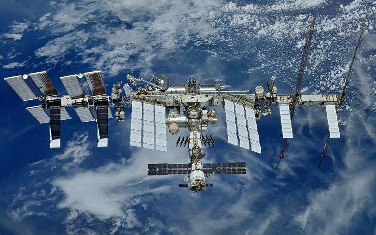 Space show 'Space Hero' signs an agreement on a space act with NASA