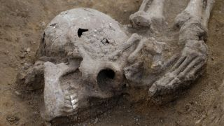 Many of the decapitated skeletons had their heads buried like the one shown here.