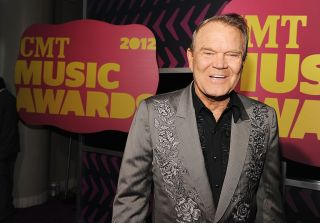 Glen Campbell arrives at the 2012 CMT Music awards at the Bridgestone Arena on June 6, 2012 in Nashville, Tennessee.