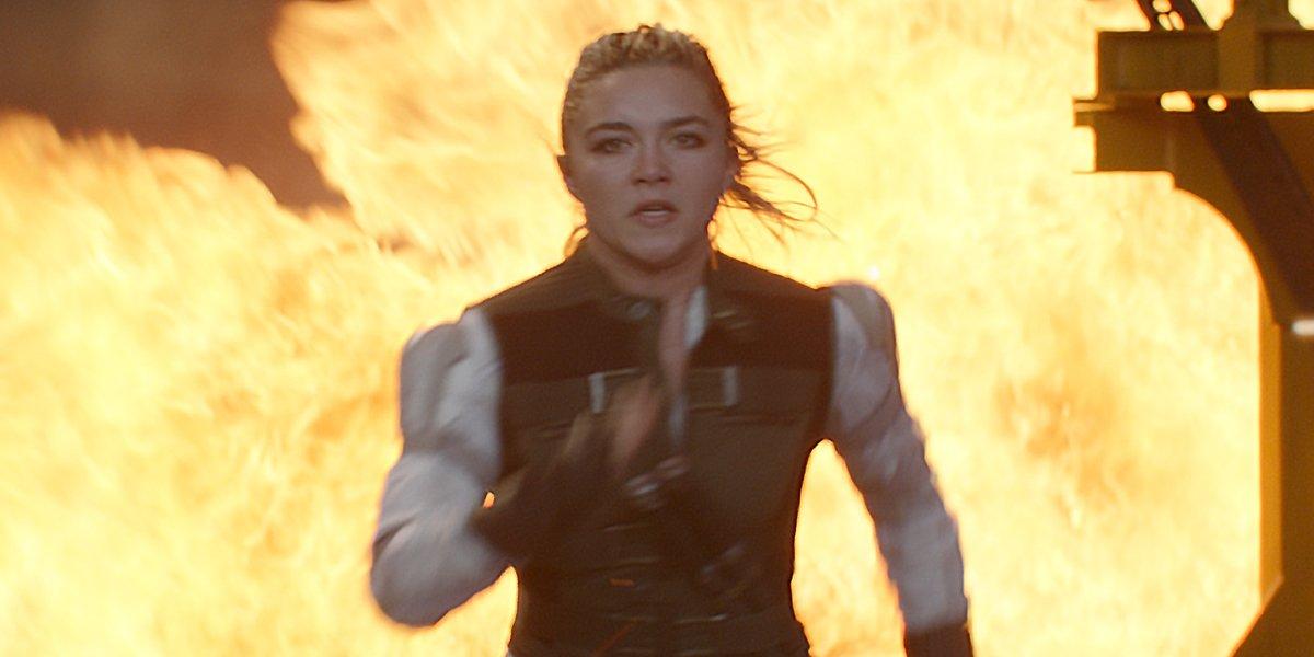 Black Widow Florence Pugh as Yelena runs away from explosion